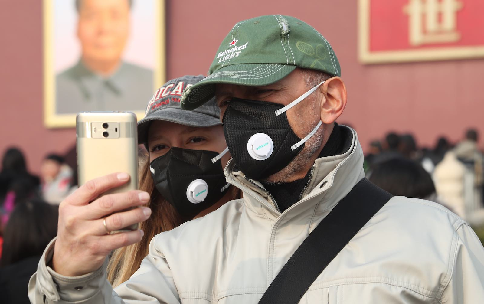 Tourists take a selfie in smog and fog this month at Tiananmen Square, Beijing (Photo: VGC via Getty)