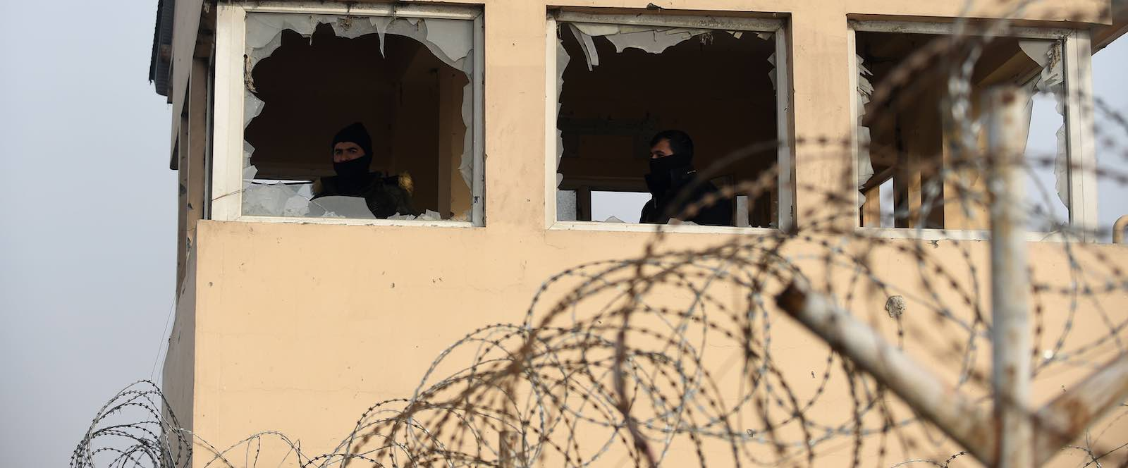 Private security guards in Kabul keep watch near the site of a 15 January attack claimed by the Taliban (Photo: Wakil Kohsar via Getty)