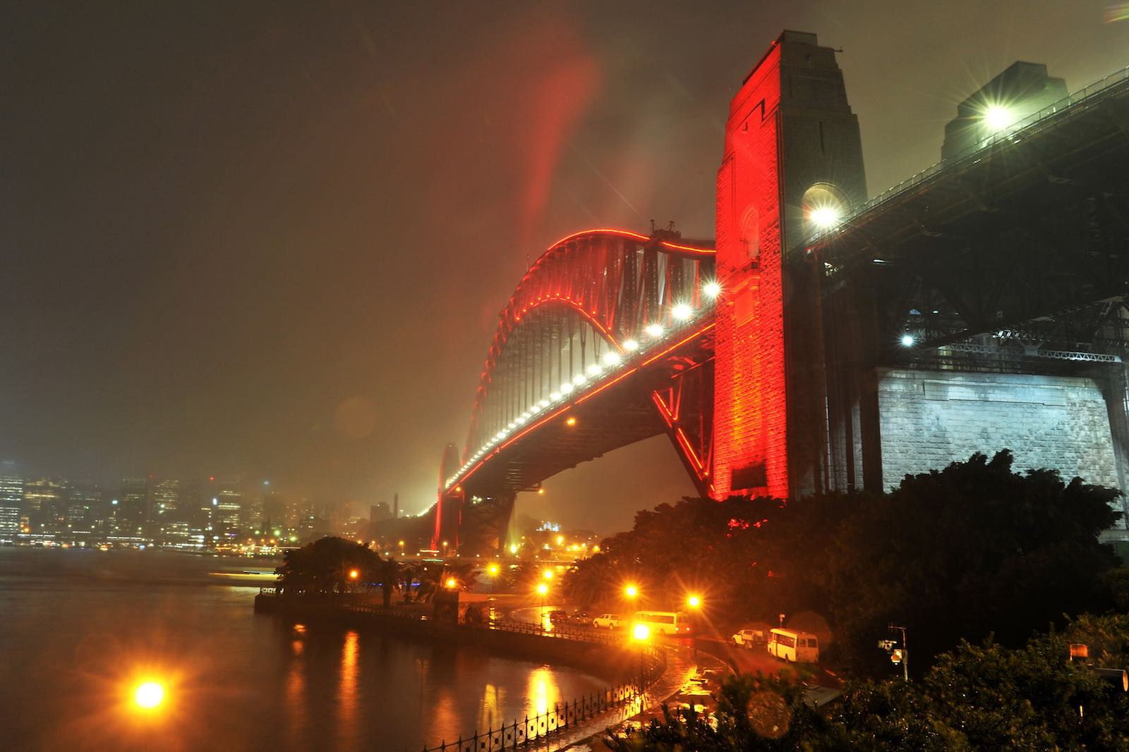 The Sydney Harbour Bridge is lit up in red ahead of the Lunar New Year in Sydney in February (Photo: Farooq Khan via Getty)