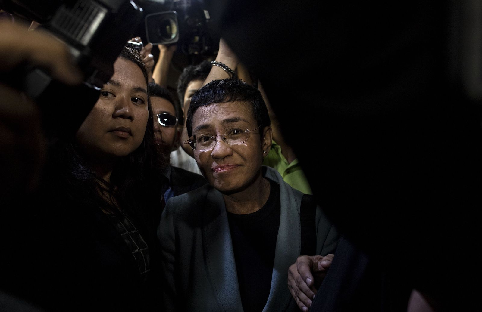 Philippine journalist Maria Ressa (centre) arrives at a regional trial court in Manila to post bail in February 2019 (Noel Celis/AFP via Getty Images)
