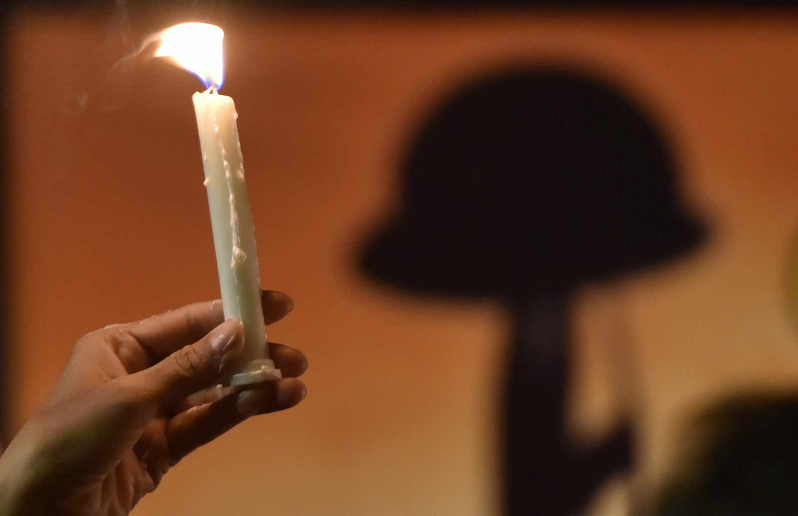 Tributes to the slain following the 14 February attack (Photo: Mohd Zakir via Getty)