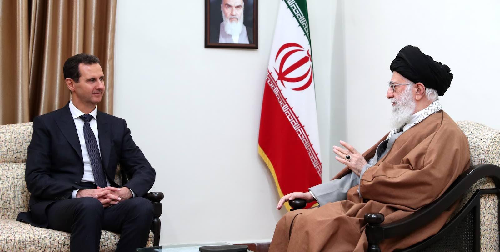 Iran's Ayatollah Ali Khamenei meets Syrian leader Bashar al-Assad in Tehran on 25 February (Photo by Iranian Leader Press Office via Getty)