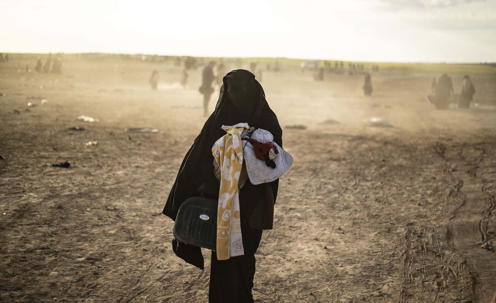 A woman evacuated from the Islamic State's holdout of Baghouz arrives at a screening area held by Kurdish-led Syrian Democratic Forces, Deir Ezzor province, Syria, March 2019. (Photo: Delil Souleiman/AFP/Getty Images)