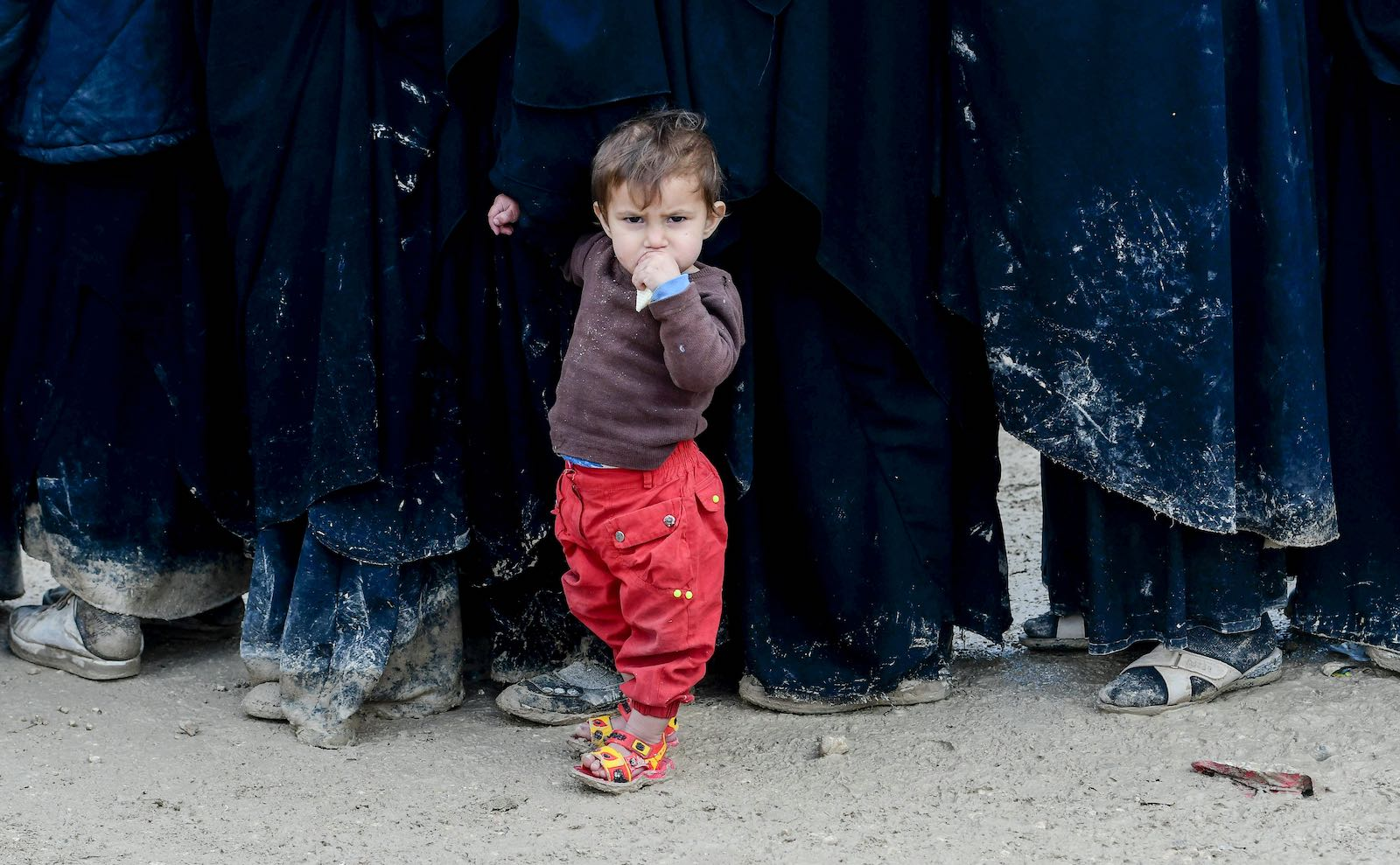 A child stands in queue in al-Hol camp, housing relatives of ISIS members, northeastern Syria (Photo: Giuseppe Cacace via Getty)