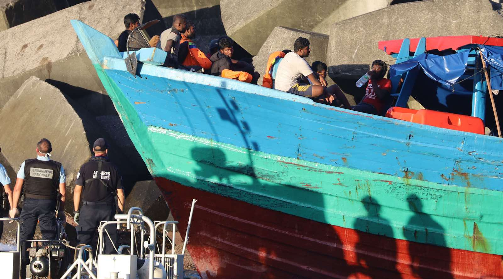 French gendarmes arrive to disembark migrants from a boat on 13 April in Sainte-Rose, on the French Indian ocean island of Réunion (Photo: Richard Bouhet/AFP/Getty Images)
