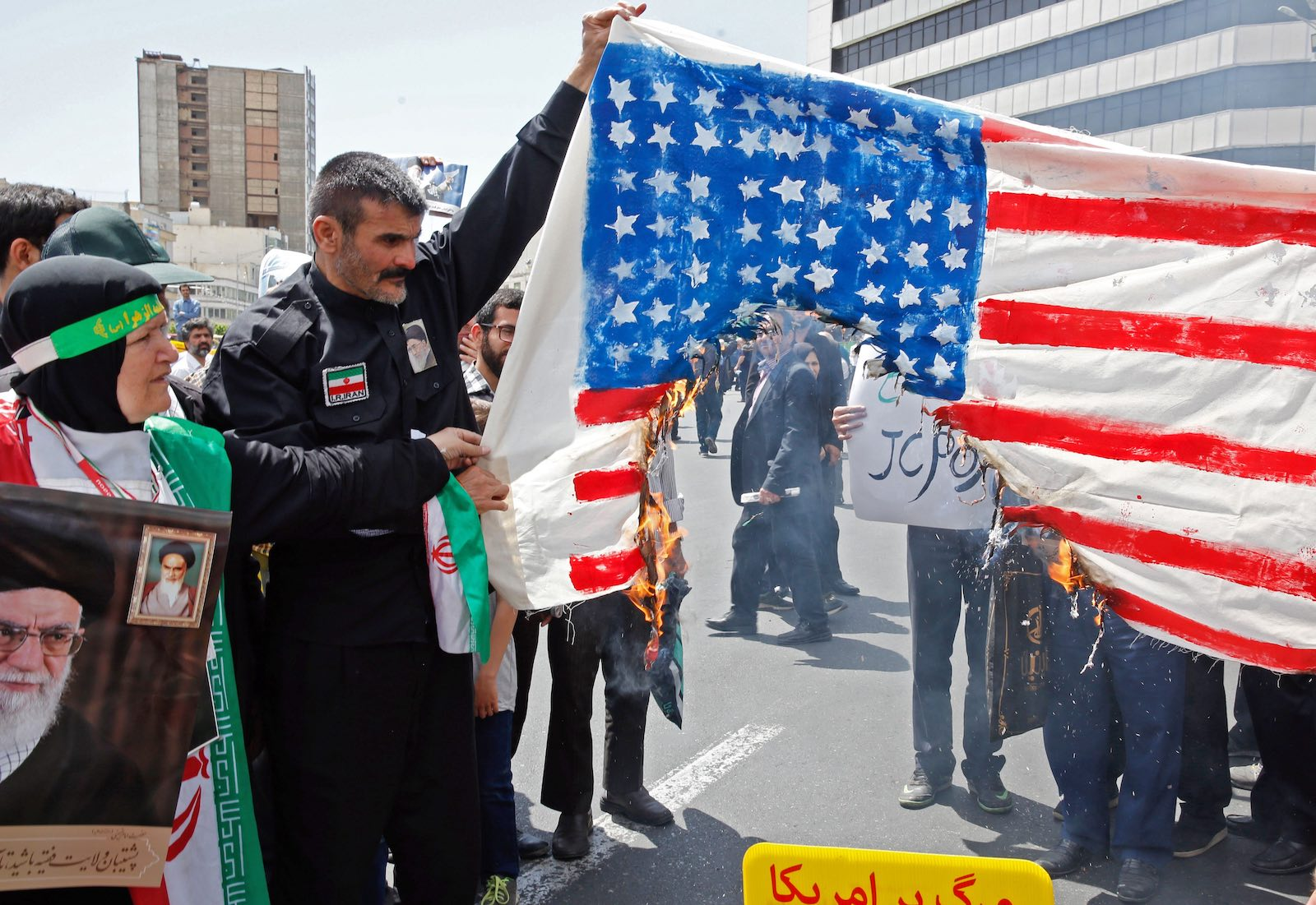 Demonstrators burn a makeshift US flag in Tehran this month (Photo: STR via Getty)