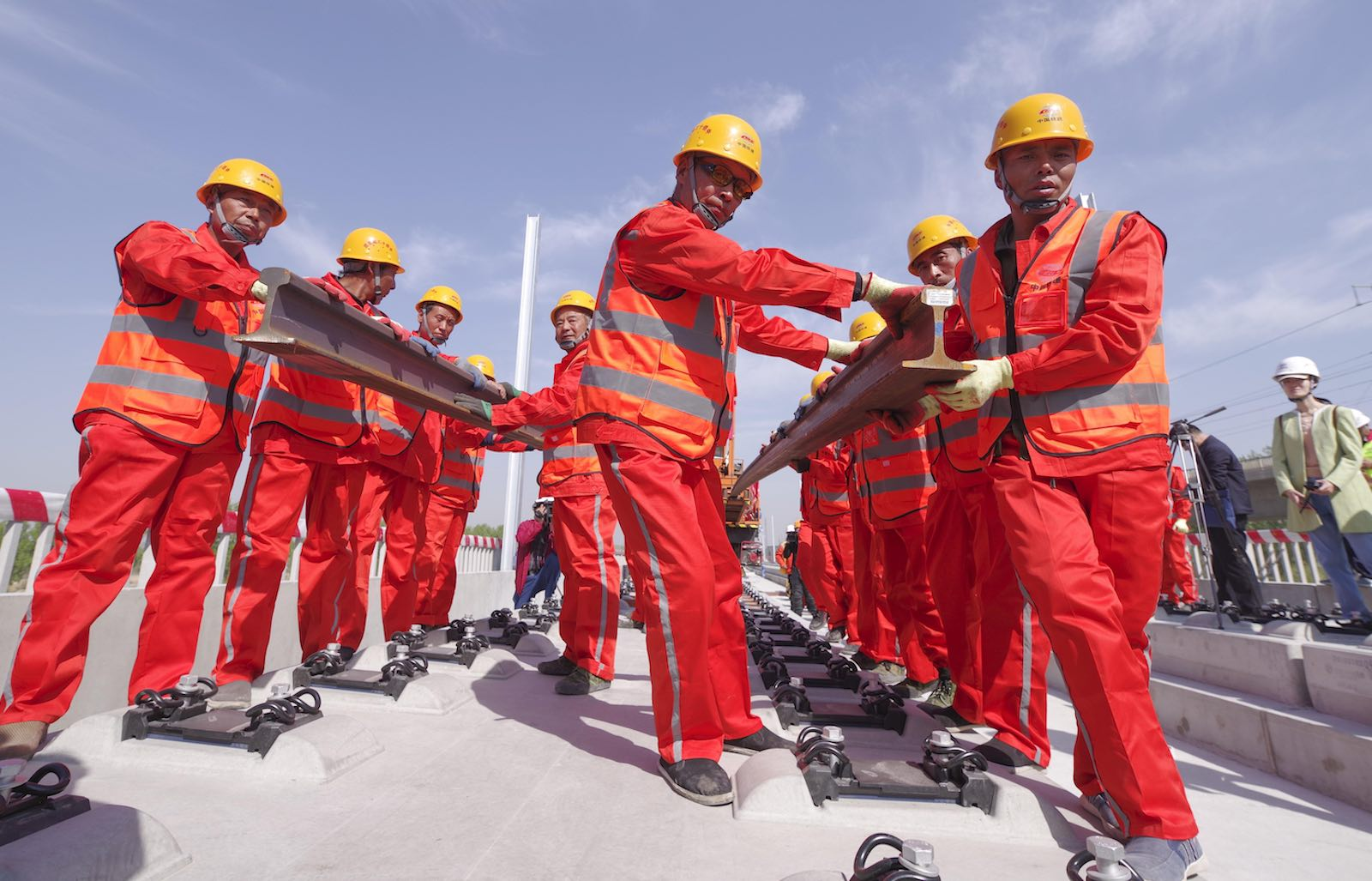 Workers lay rails for the Beijing-Xiong'an Intercity Railway (Photo: Jia Tianyong via Getty)