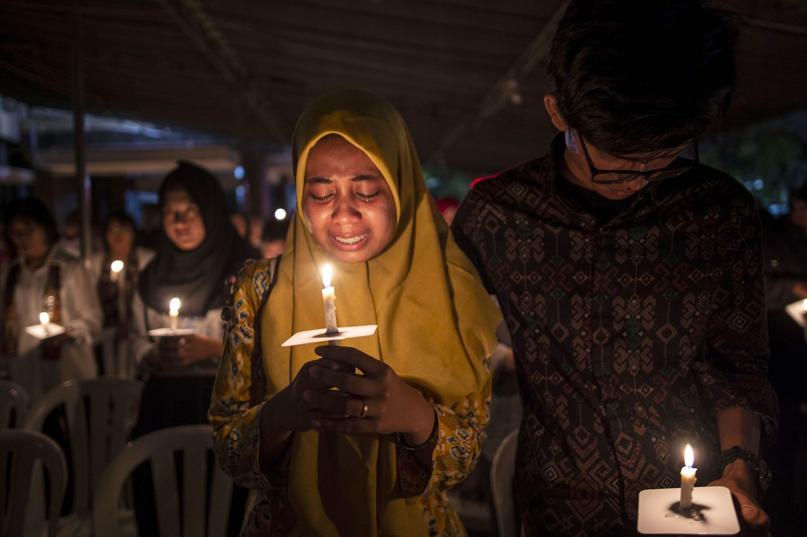 Tears during a candlelight vigil to remember the victims of the 2018 Surabaya suicide bombings (Photo: Juni Kriswanto via Getty)