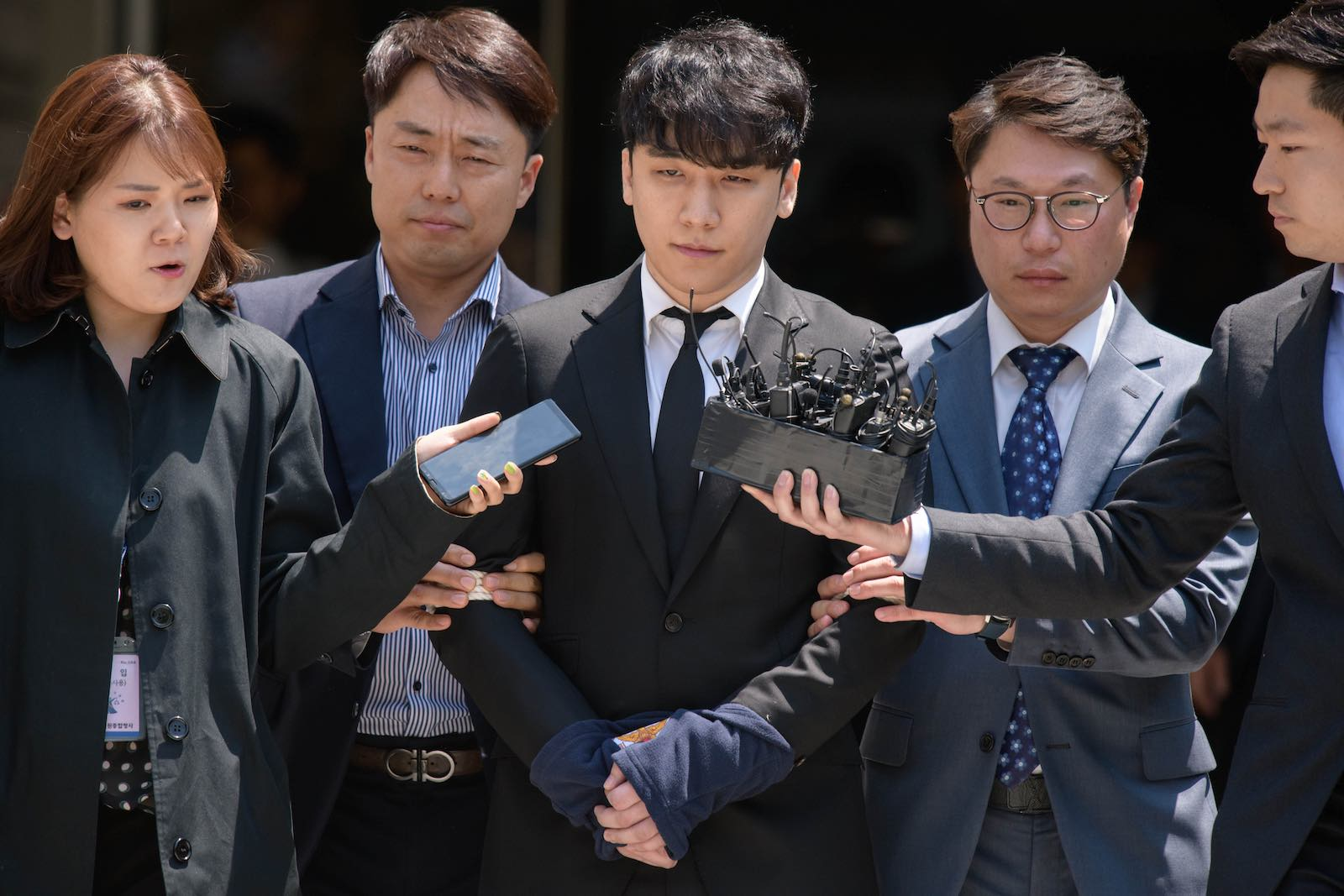 Former Big Bang boyband member Seungri, centre, real name Lee Seung-hyun, leaves the High Court in Seoul in May (Photo: Ed Jones via Getty)