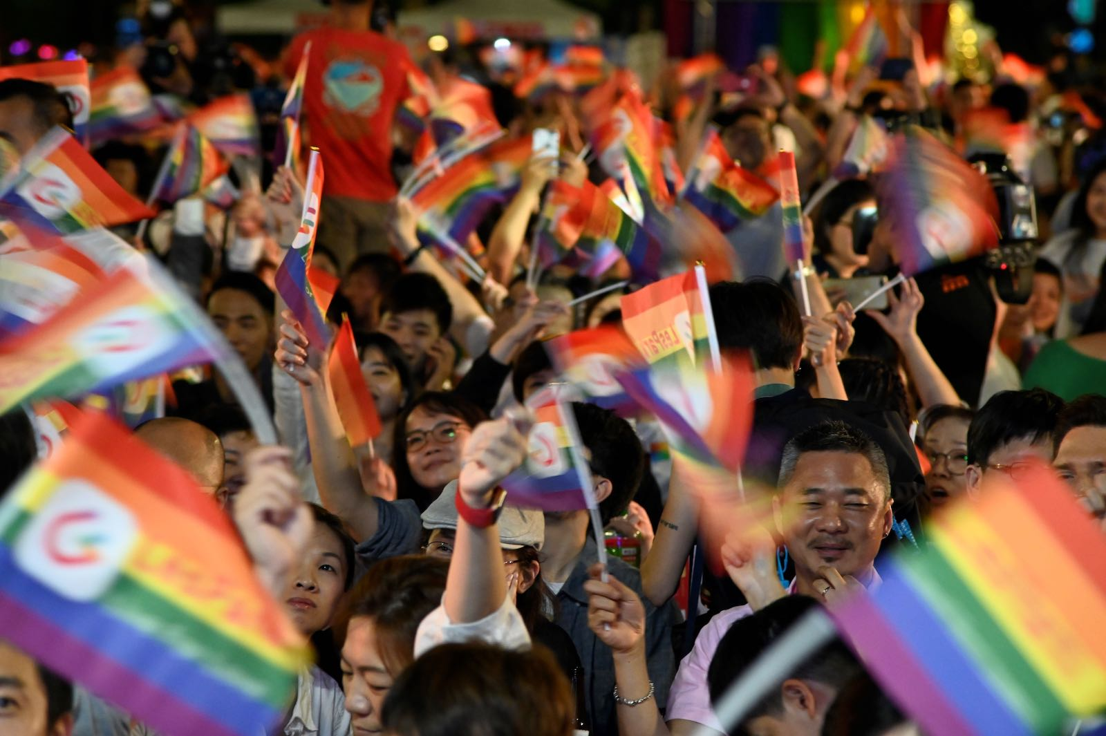 Rainbow flags during a mass wedding banquet for gay couples in front of the Presidential Palace in Taipei on 25 May (Photo: Sam Yeh via Getty)