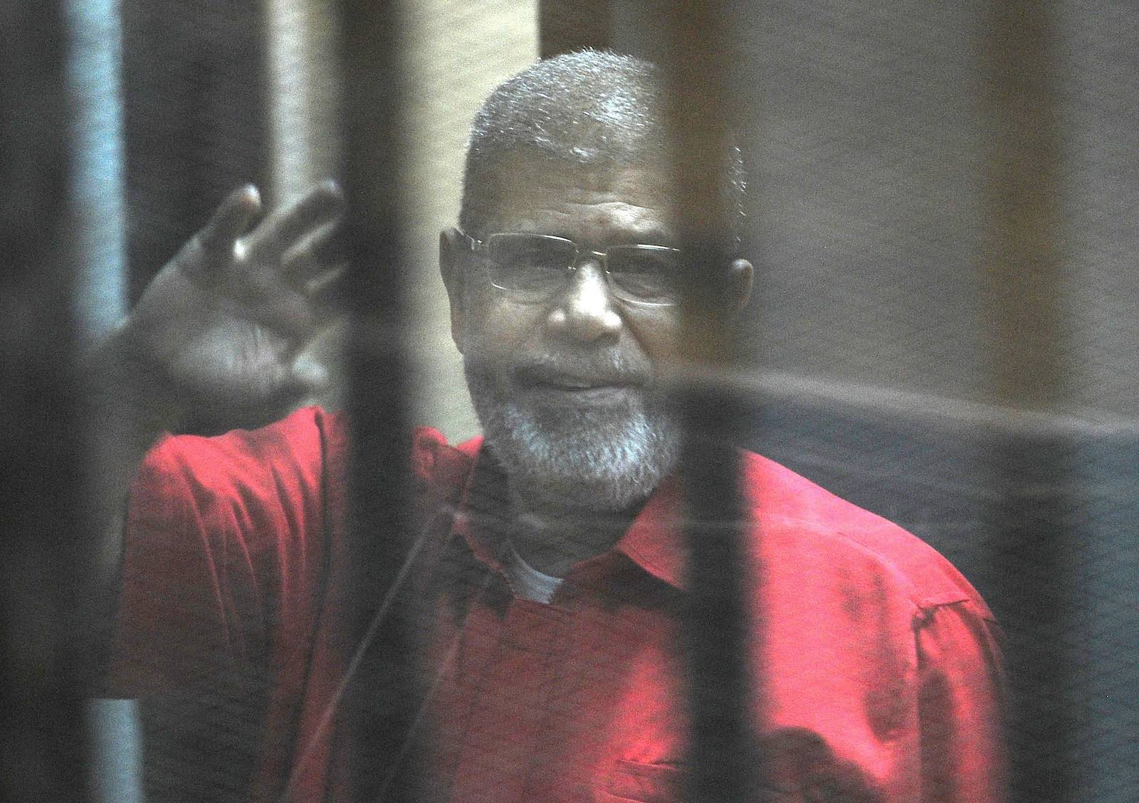 Former Egyptian president Mohamed Morsi in court in 2015 after his ousting (Photo: Ahmed Omar via Getty)