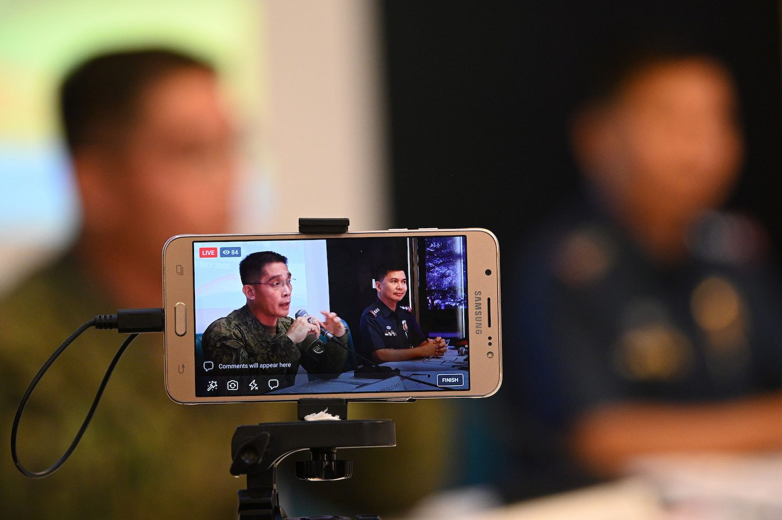 Philippine security personnel brief the media on investigations following a June bombing (Photo: Ted Aljibe via Getty)