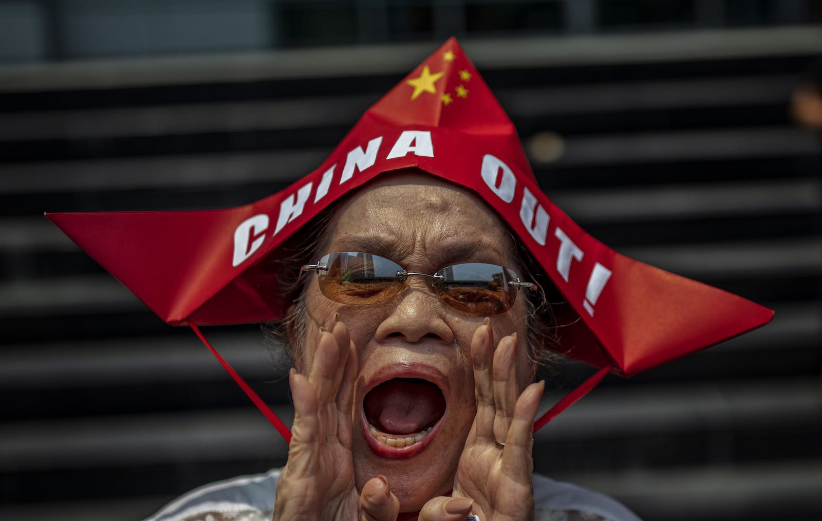 A woman shouts during a protest outside the Chinese Embassy in Manila, Philippines, 12 July 2019 (Photo: Ezra Acayan/Getty Images)