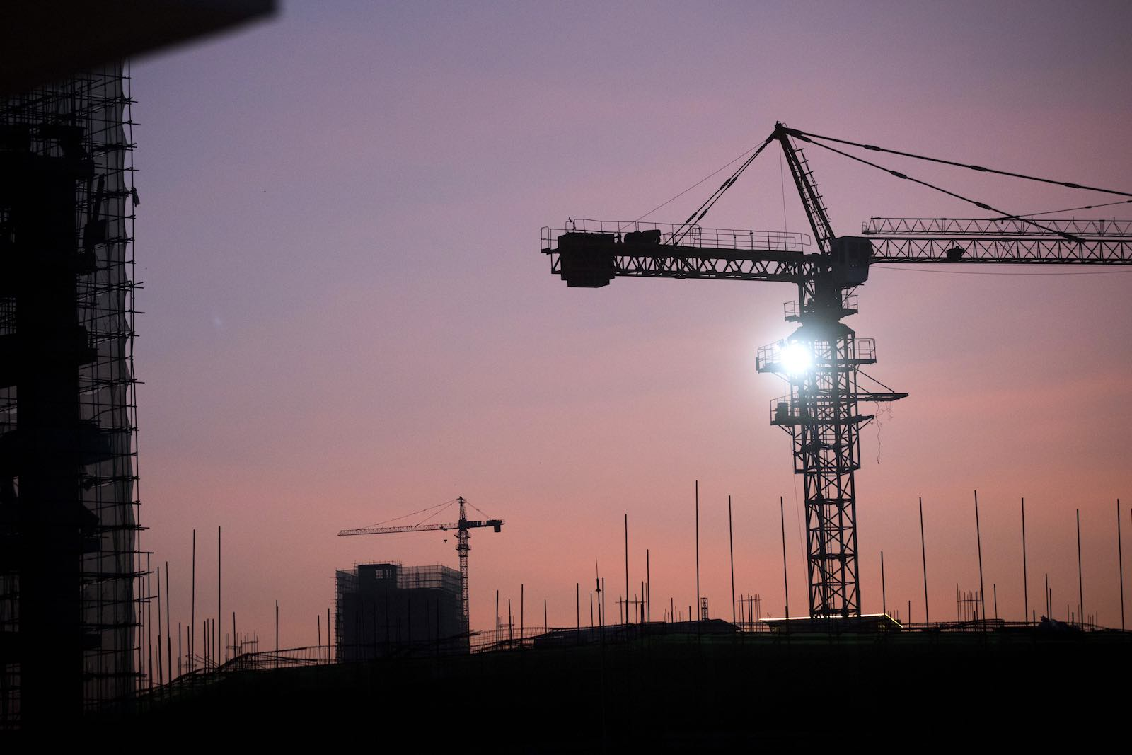 Cranes stand on a construction site at dawn in Sihanoukville, Cambodia, part of an infusion of Chinese-built infrastructure (Photo: Brent Lewin via Getty)