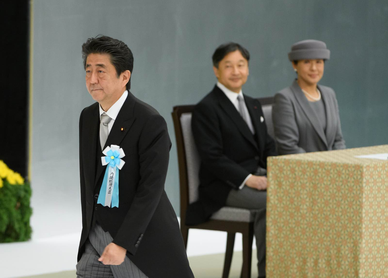 Japanese PM Shinzo Abe walks past Emperor Naruhito and Empress Masako during a service to mark the 74th anniversary of the end of the Second World War, Tokyo, 15 August 2019 (Photo: Akio Kon via Getty)