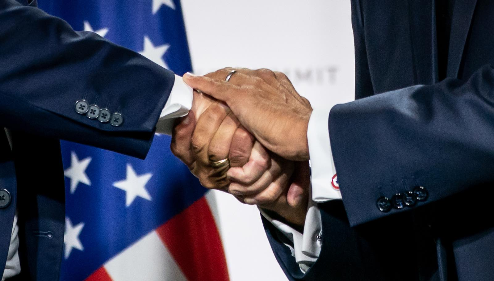 US President Trump and French President Emmanuel Macron shake hands at the final press conference of the G7 Summit, Biarritz, France, 26 August 2019 (Photo: Michael Kappeler via Getty)