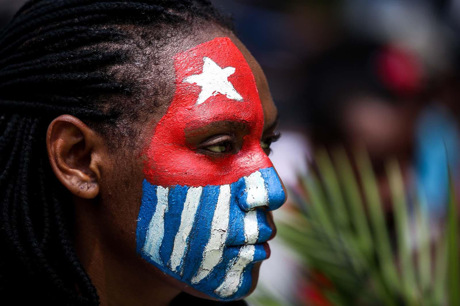 A Papuan student, her face painted with the West Papua flag, during a rally in Jakarta, Indonesia, 28 August 2019 (Andrew Gal/NurPhoto via Getty Images)