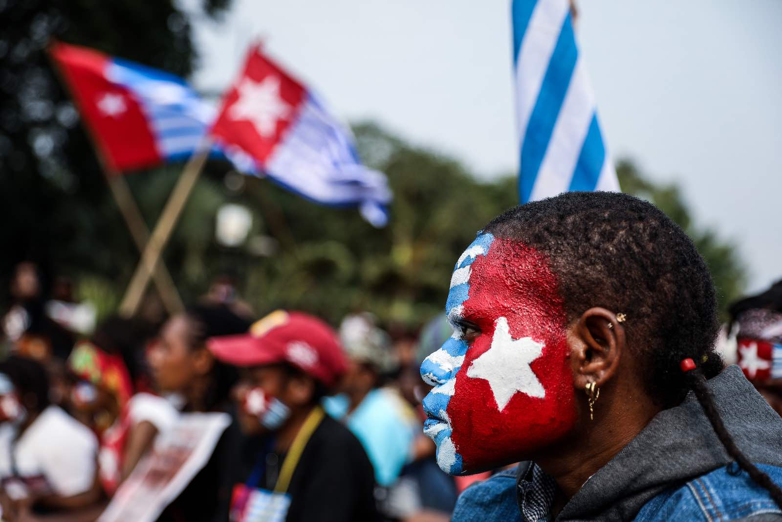 A woman with her face painted with the flag of West Papua, at a rally in Jakarta, Indonesia, 28 August 2019 (Andrew Gal/NurPhoto via Getty Images)