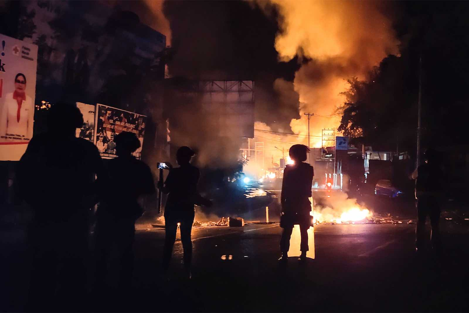 Buildings burn after hundreds of demonstrators marched near Papua's biggest city, Jayapura, on 29 August (Photo: Indra Thamrin Hatta/AFP/Getty Images)