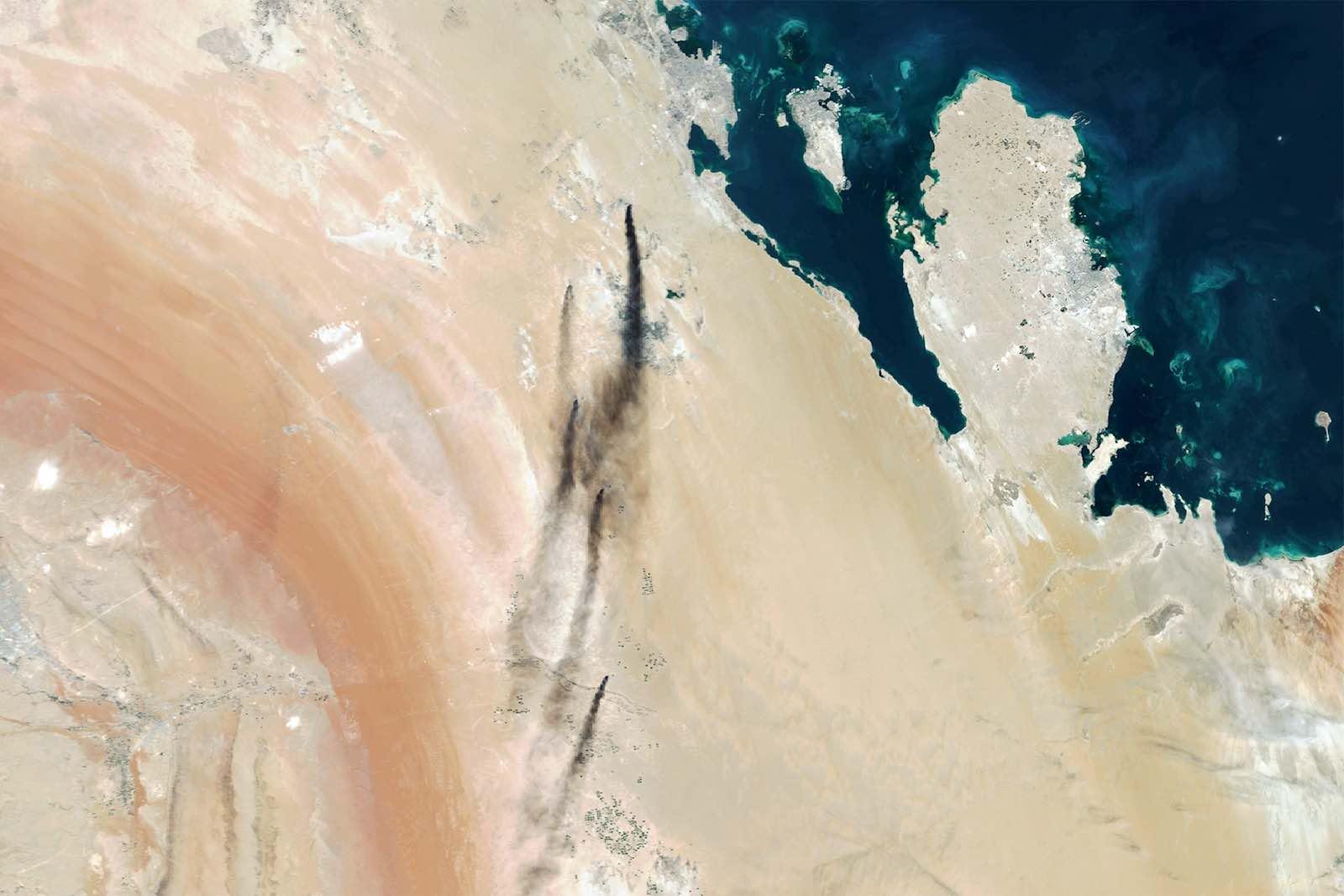 Smoke billows from Saudi Aramco's oil processing plants in Abqaiq and Khurais, Saudi Arabia. (Photo by Orbital Horizon via Getty Images)