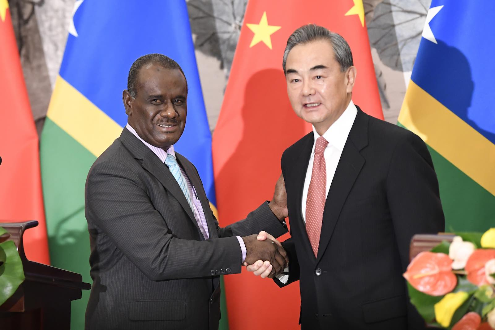 New friends: Solomon Islands Foreign Minister Jeremiah Manele (L) and Chinese Foreign Minister Wang Yi, on 21 September 2019 in Beijing (Photo: Naohiko Hatta via Getty)