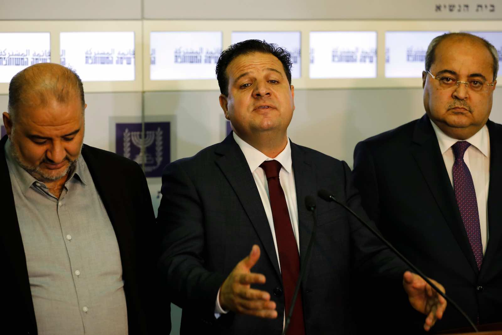 Ayman Odeh (centre) with members of the Joint Arab List (Photo: Menahem Kahana/AFP/Getty Images)