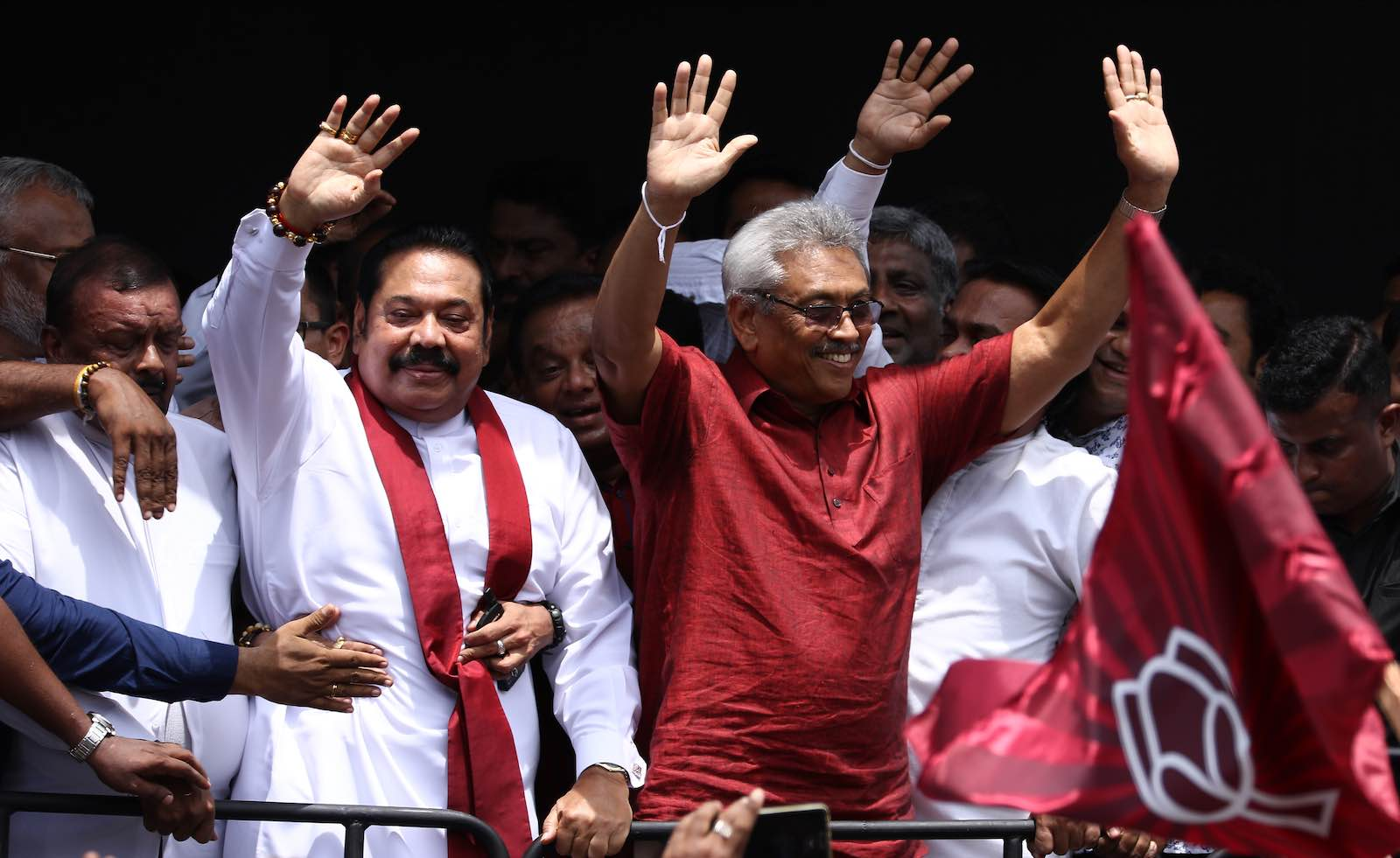 Sri Lankan presidential candidate Gotabaya Rajapaksa (R) and his brother, former president Mahinda Rajapaksa (L), greet supporters in Colombo, 7 October 2019. (Photo by Tharaka Basnayaka/NurPhoto via Getty)
