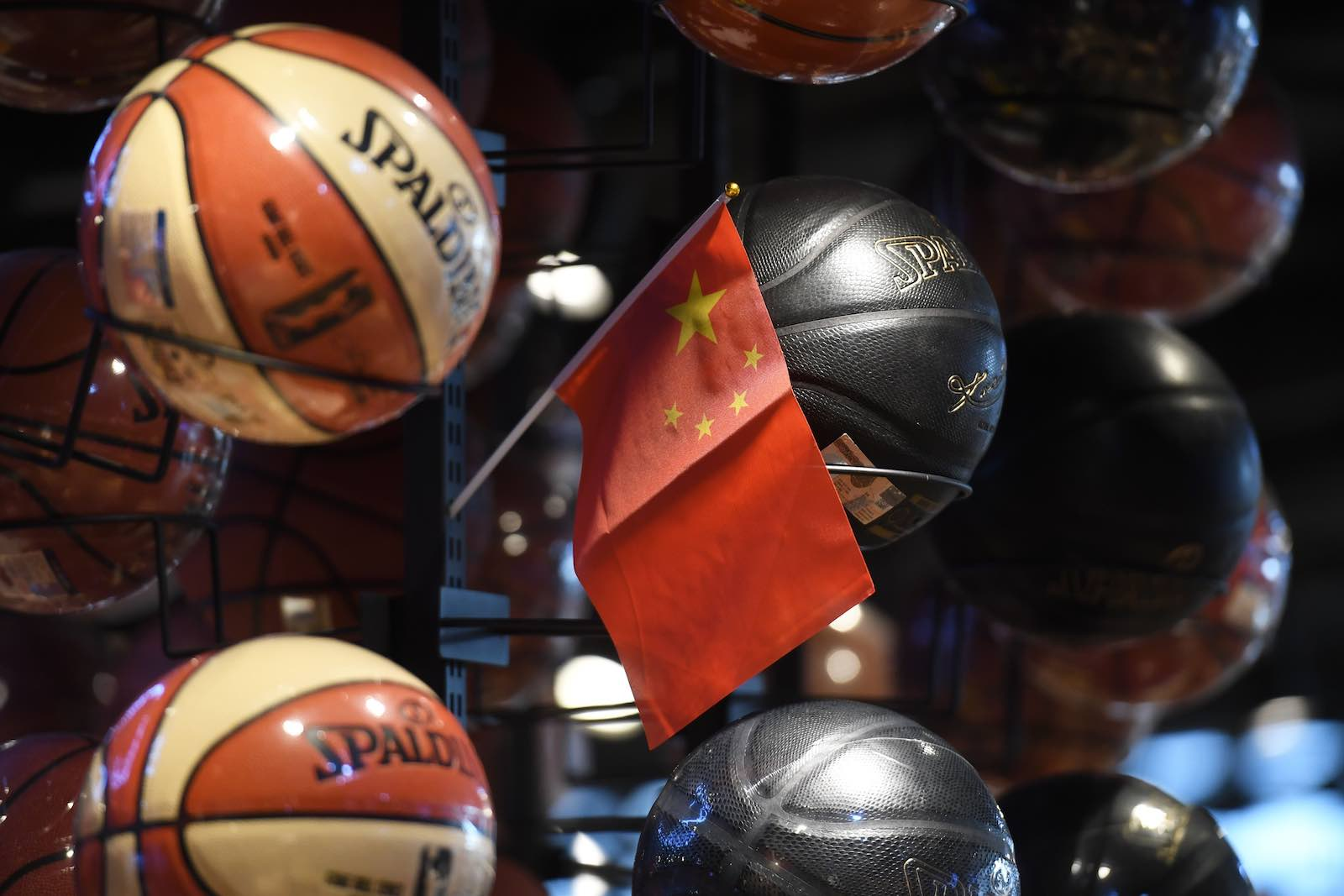 A Chinese flag is placed into a display of basketballs in the National Basketball Association (NBA) store in Beijing this month (Photo: Greg Baker/AFP/Getty Images)