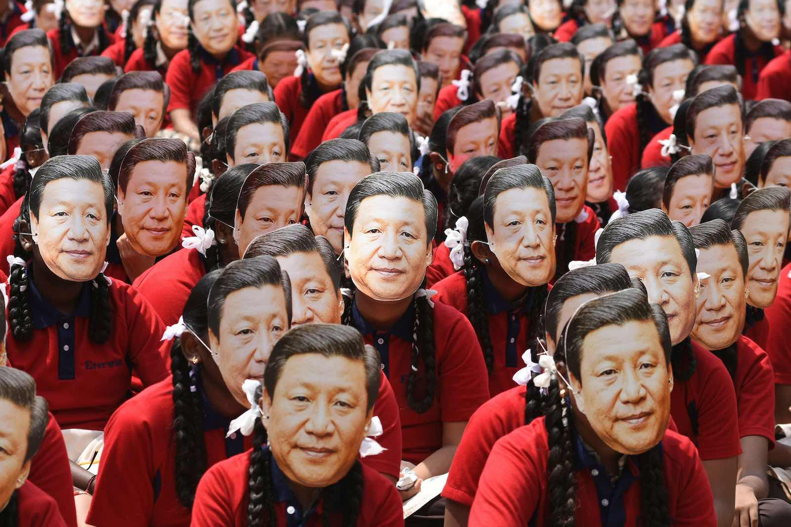 Indian school students wear masks of China's President Xi Jinping in Chennai ahead of a summit in October with his Indian counterpart Narendra Modi at Mamallapuram (Arun Sankar/AFP via Getty Images)