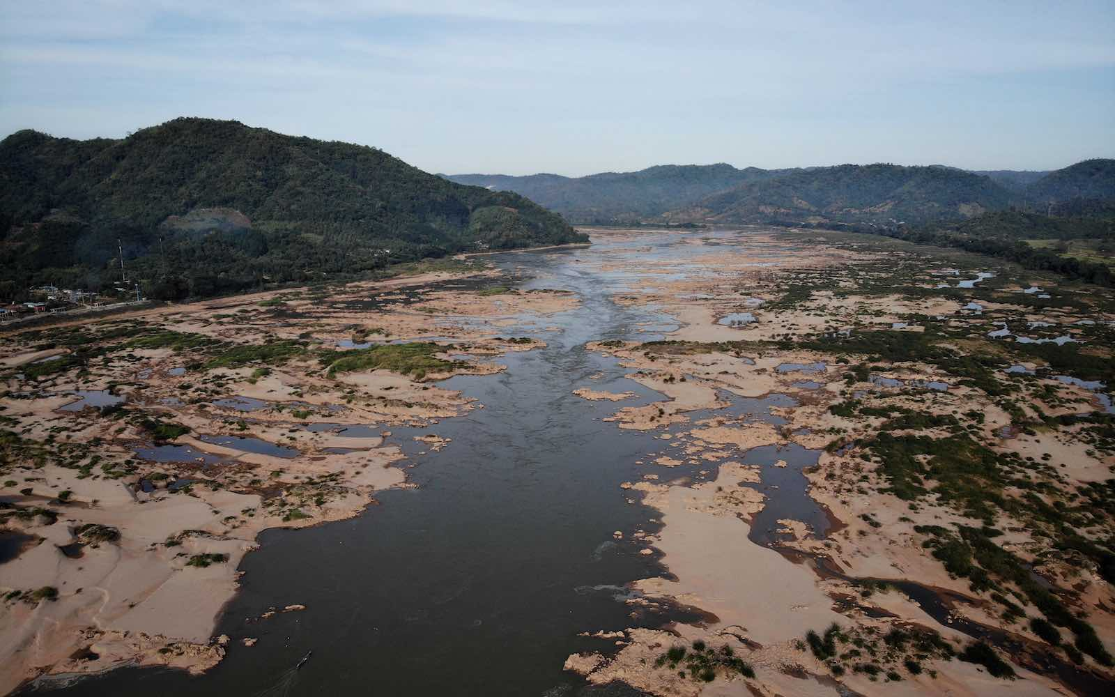 Record low levels on the Mekong River dividing the north-eastern Thai province of Loei, at left, with the Laos side seen at right, October 2019 (Lillian Suwanrumpha/AFP via Getty Images)