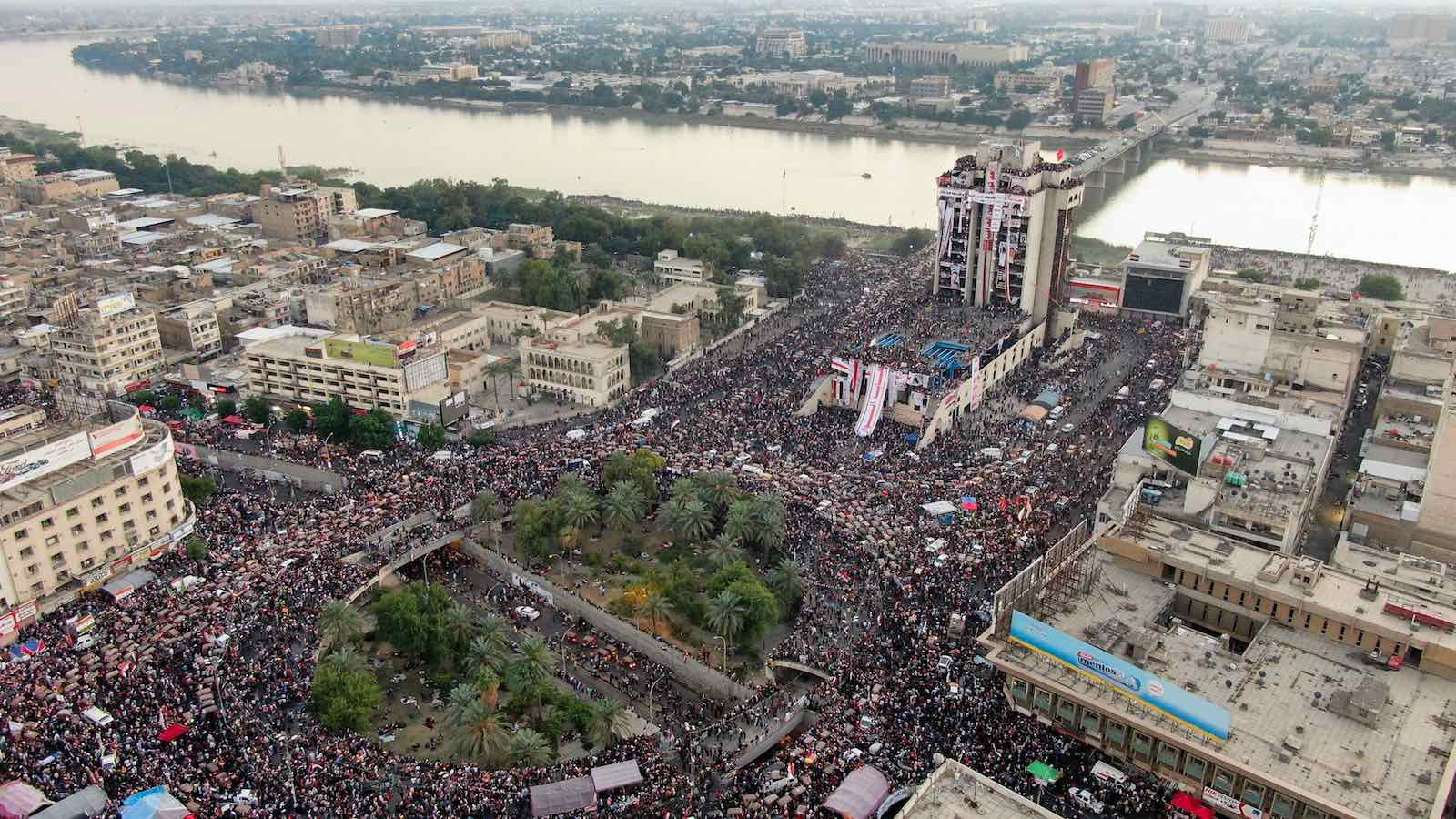 Iraqi protesters gathering last month at Baghdad's Tahrir square (Photo: AFP via Getty Images)