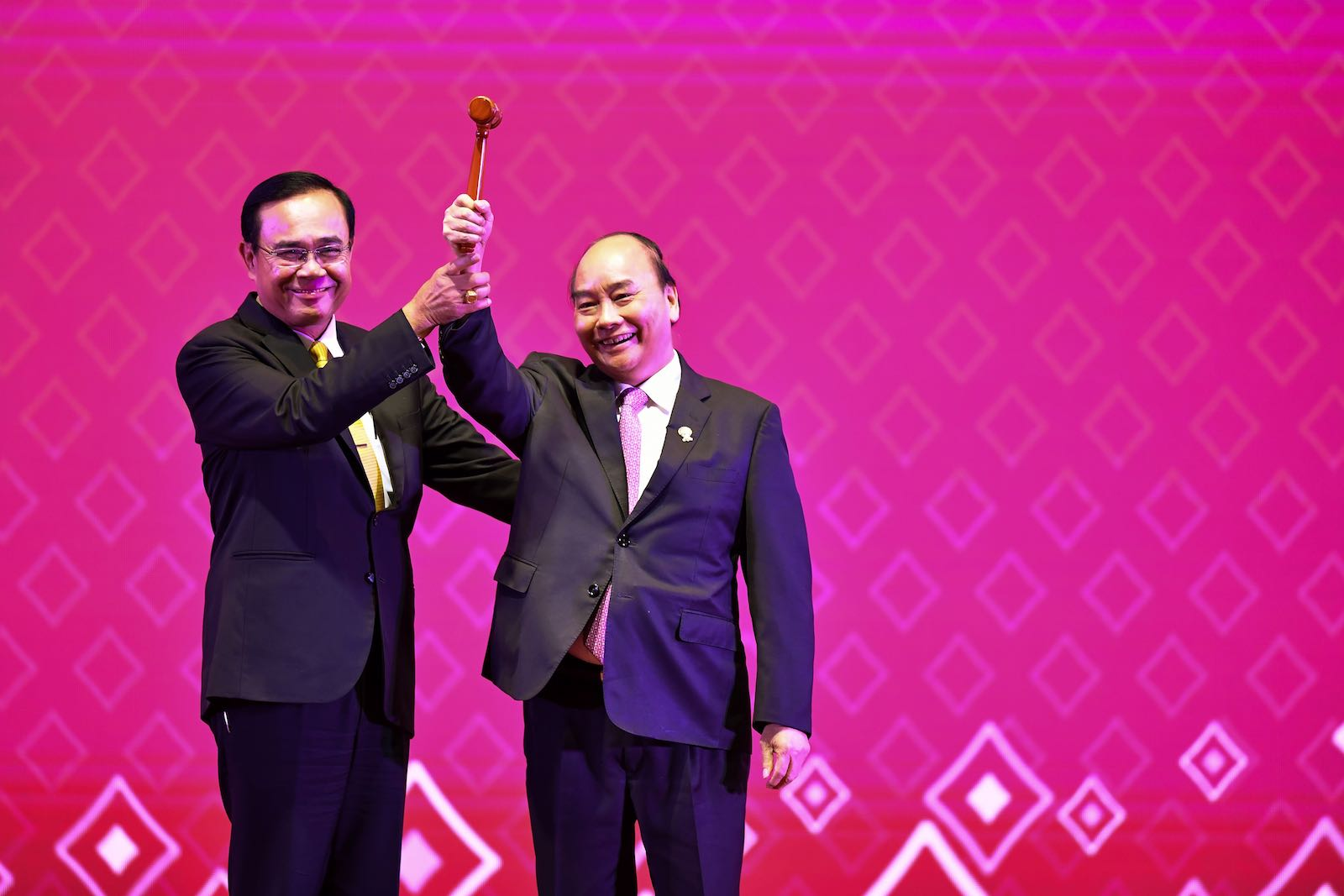 Vietnam's Prime Minister Nguyen Xuan Phuc raises the gavel as ASEAN chair for 2020 after a handover from Thailand's Prayut Chan-O-Cha (Photo: Lillian Suwanrumpha/AFP/Getty Images)