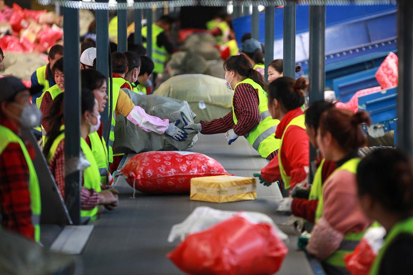 "Sorting out packages at a delivery warehouse on ""Singles' Day"" – the world's biggest 24-hour shopping event – in Yangzhou, China (Photo: STR/AFP/Getty Images)"