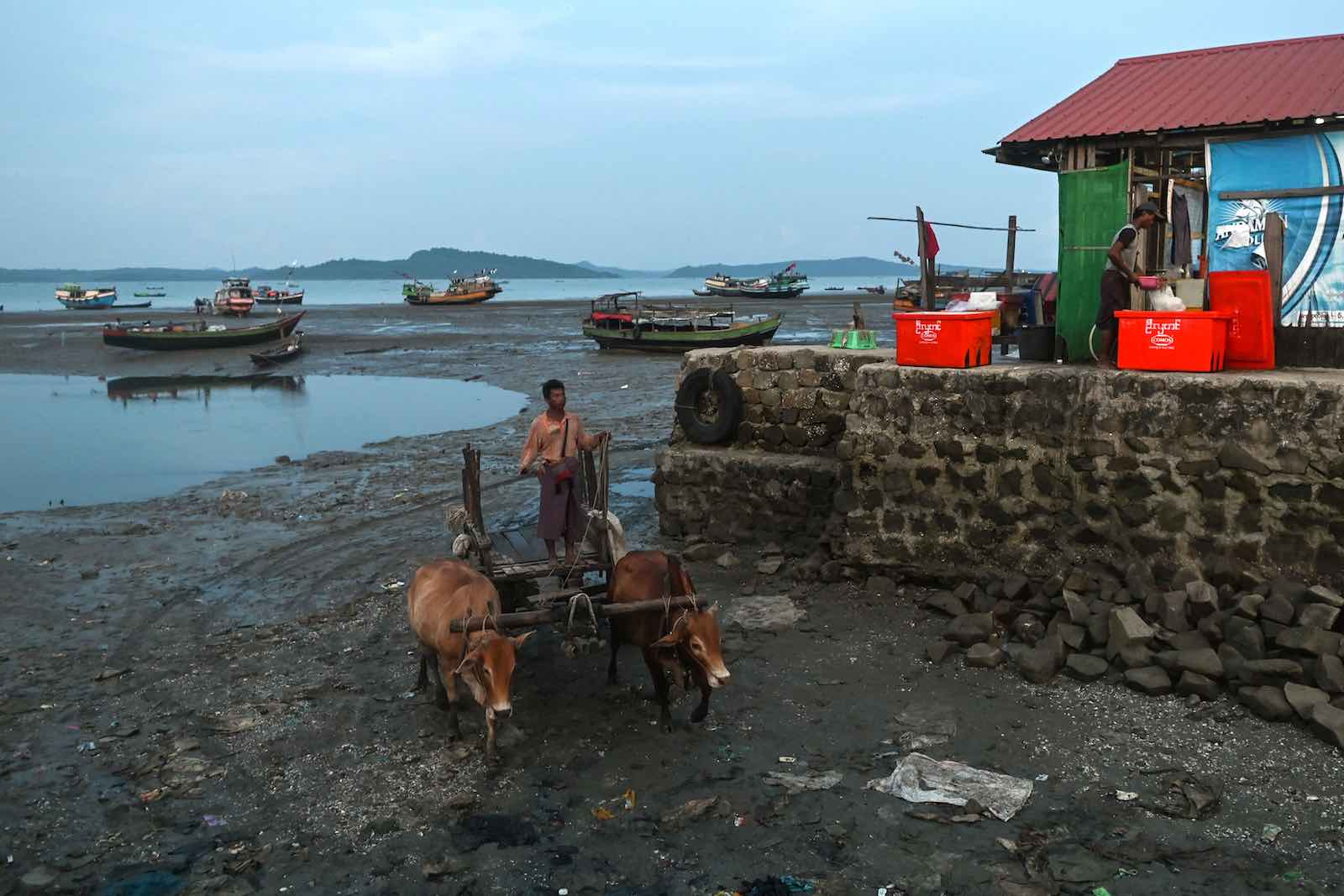 A man transports goods to shore at Japanma jetty in Kyaukphyu, Rakhine state, where China is financing a deep-sea port and a special economic zone, October 2019 (Photo: Ye Aung Thu/AFP via Getty)