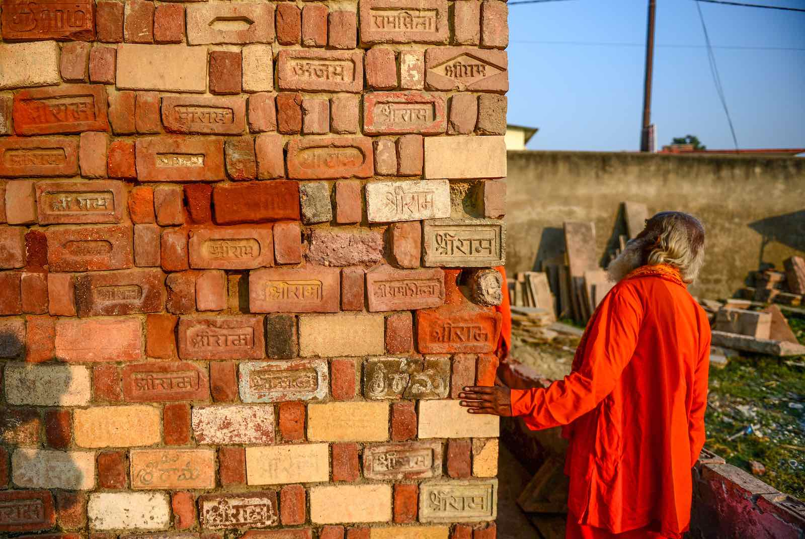 A Sadhu with bricks for the proposed Rama temple in Ayodhya following the Supreme Court verdict on the disputed religious site (Photo: Sanjay Kanojia/AFP/Getty Images)