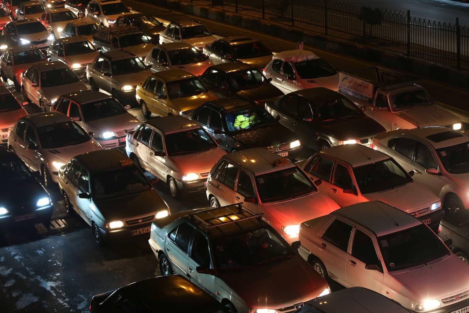 Drivers in Tehran switch off engines to block roads during a demonstration against a government decision to raise petrol prices, 16 November (Photo: Fatemeh Bahrami/Anadolu Agency via Getty)