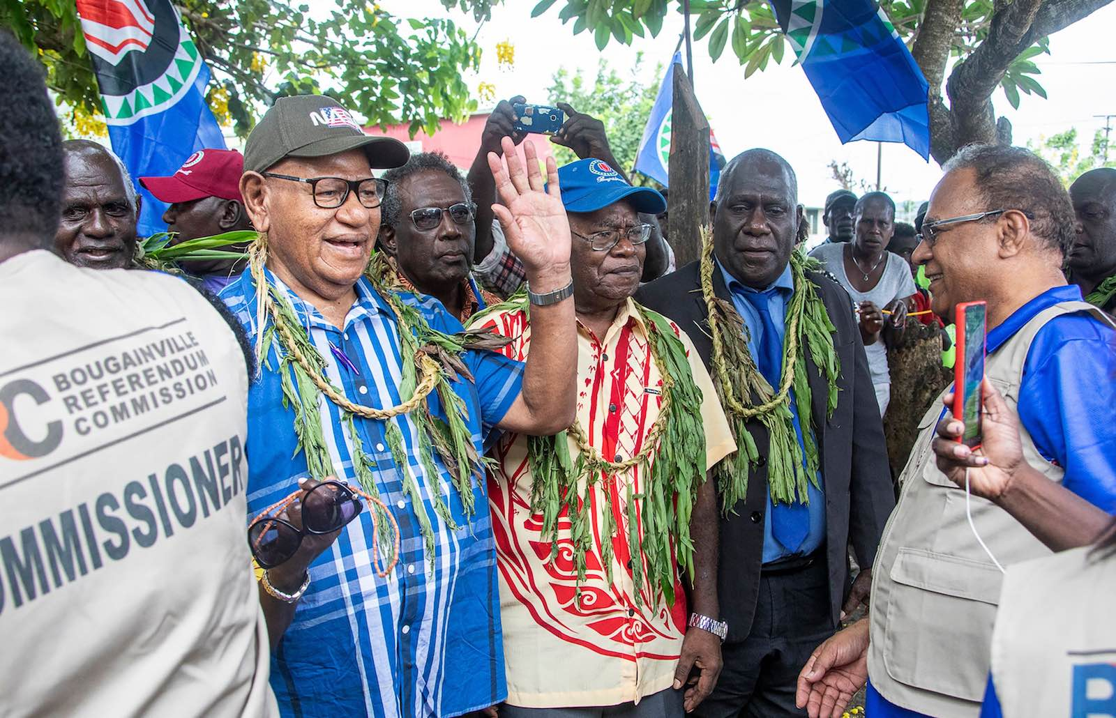 John Momis waves for the camera when about to cast a ballot in Bougainville's independence vote in Buka on 23 November 2019 (Ness Kerton/AFP/Getty Images)
