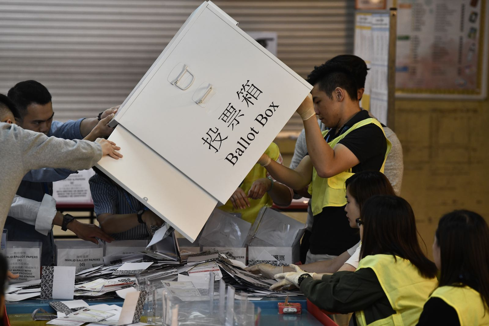 Officials unload a ballot box at a counting station during the District Council elections in Tuen Mun in Hong Kong, 24 November (Photo: Vernon Yuen/NurPhoto via Getty Images)