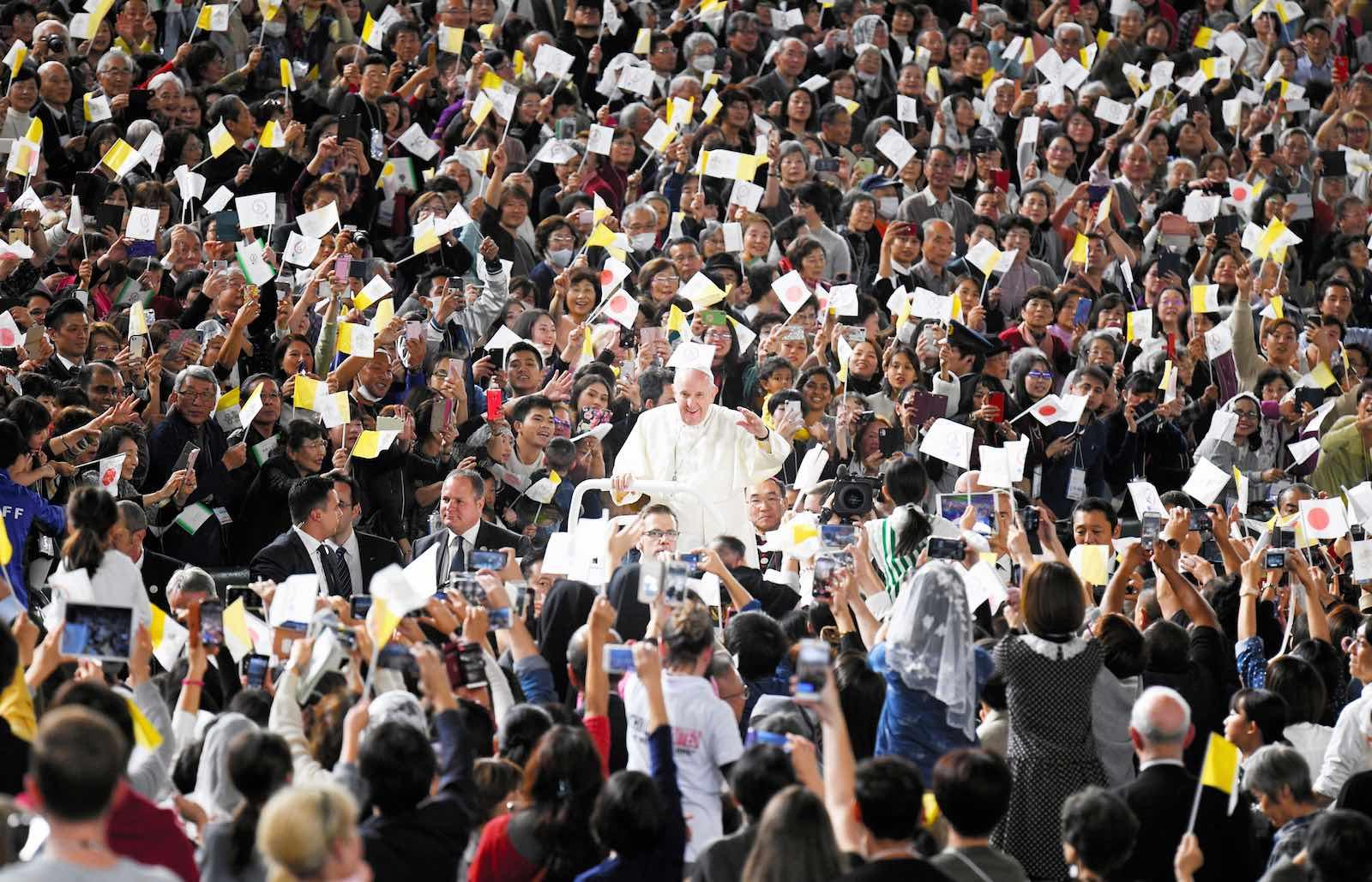 Pope Francis waves during Holy Mass at Tokyo Dome on 25 November (Photo: Asahi Shimbun via Getty Images)