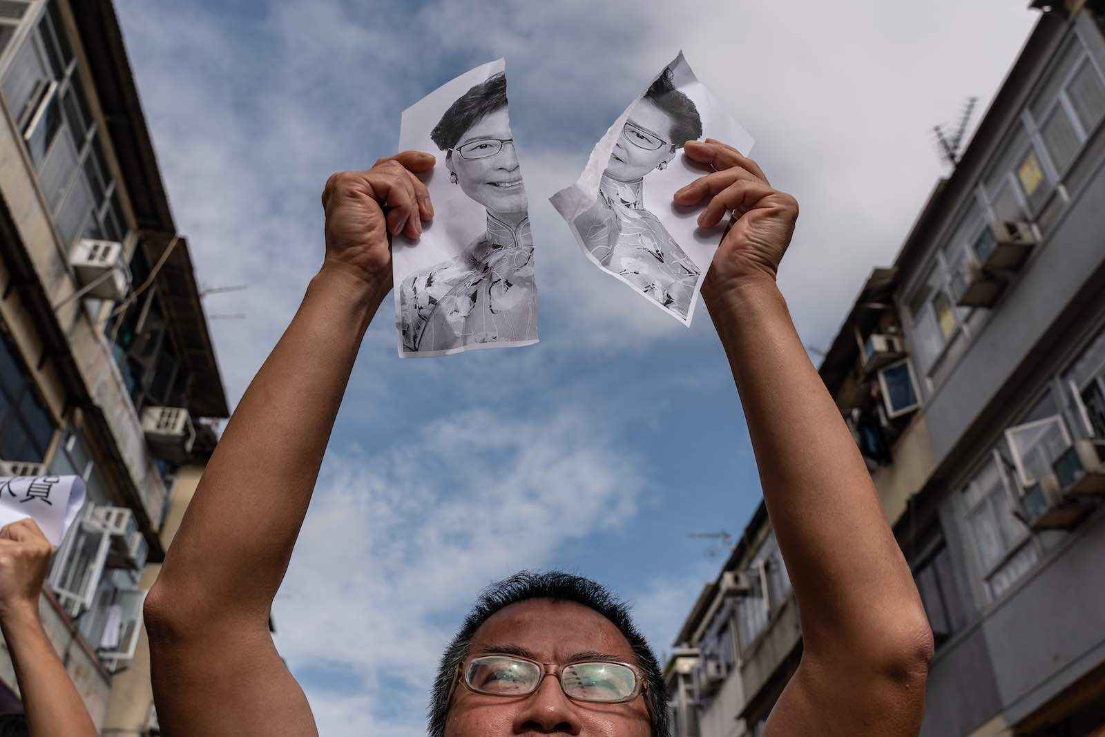 A protester holds a torn portrait of Hong Kong Chief Executive Carrie Lam during a rally in Sheung Shui district Hong Kong on 5 January 2020 (Photo: Anthony Kwan/Getty Images)