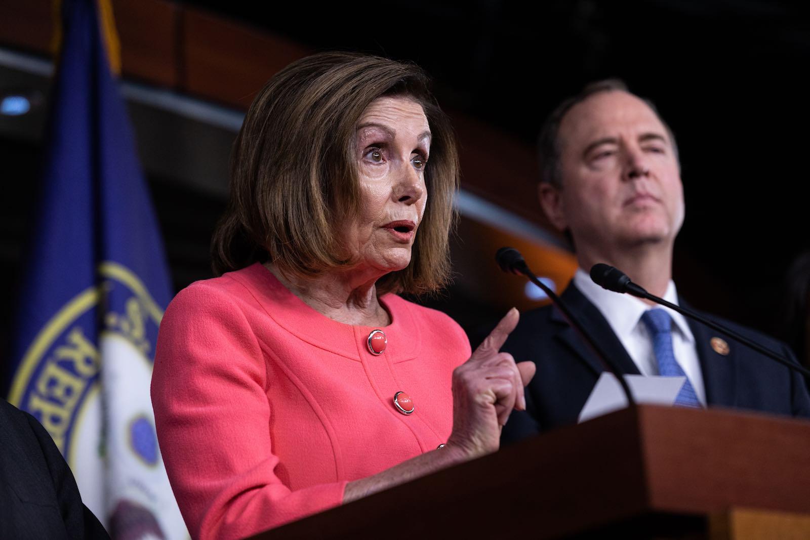 US House Speaker Nancy Pelosi announces vote on sending impeachment articles to the Senate, while Rep. Adam Schiff looks on (Photo: Aurora Samperio/NurPhoto via Getty Images)