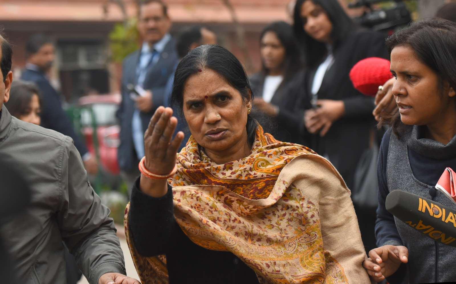 Asha Devi, mother of December 2012 gang rape victim Jyoti Singh, speaks to the media after a hearing at Supreme Court in New Delhi, 20 January (Photo: Raj K Raj/Hindustan Times via Getty)