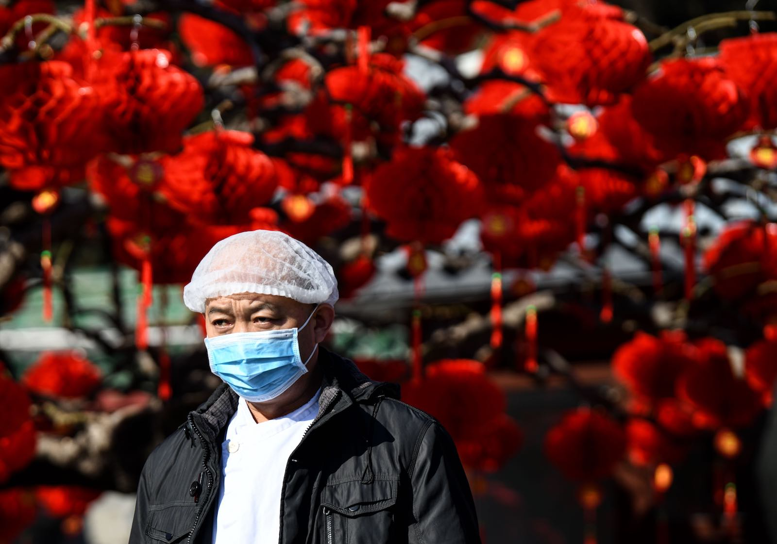 The difficulties of managing a public health crisis have been accentuated by timing, on the eve of Lunar New Year (Photo: Noel Celis/AFP/Getty Images)
