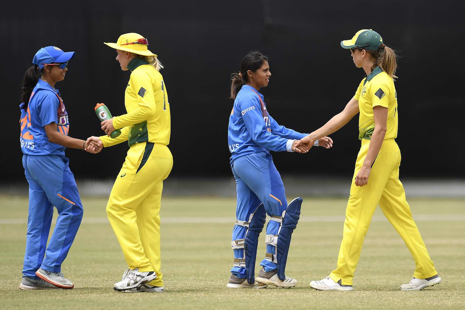 Players shake hands after a Women's T20 match between Australia A and India A last month on the Gold Coast, Australia (Photo: Albert Perez/Getty Images)