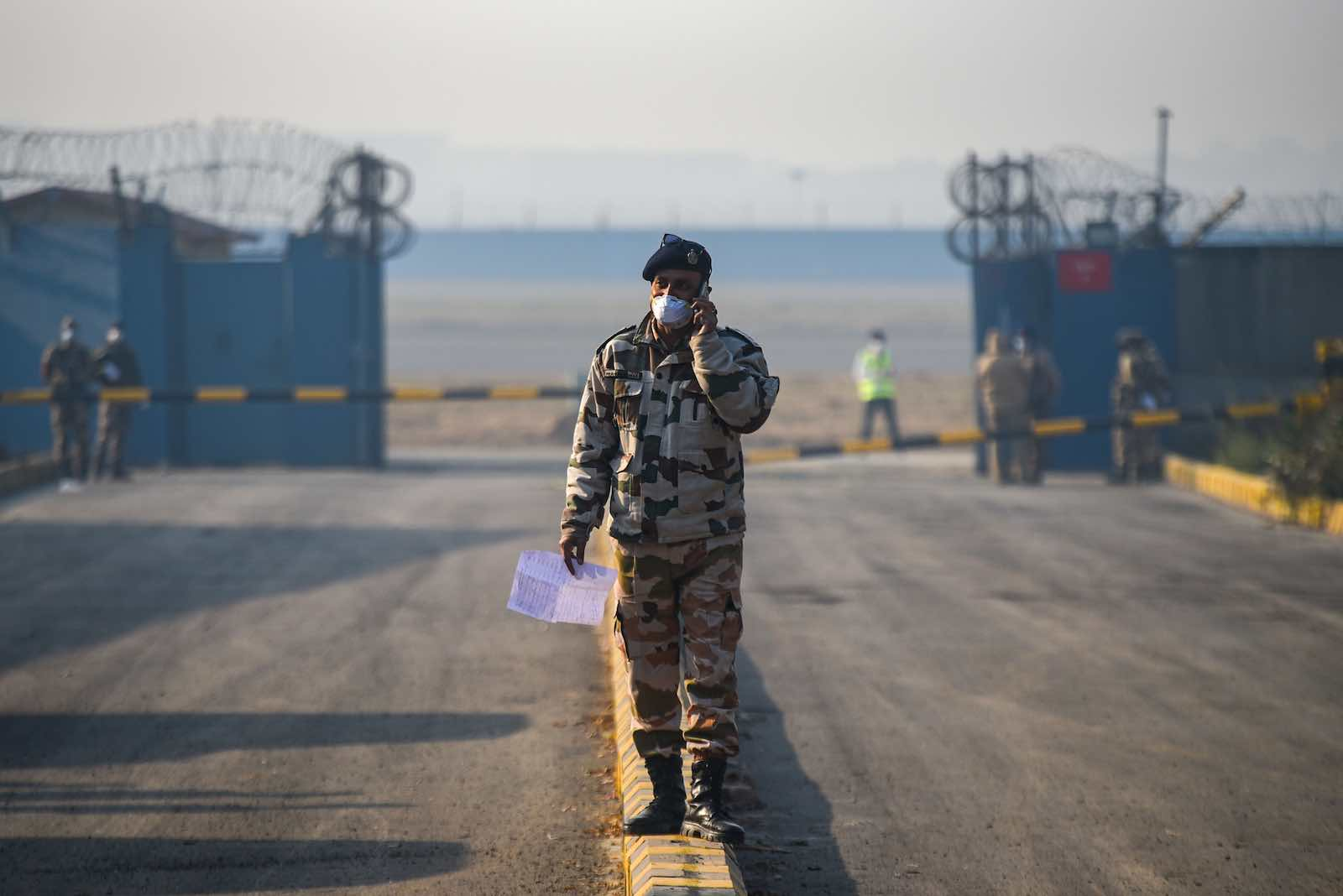 A guard at Indira Gandhi International Airport following the evacuation from Wuhan province in China (Amal KS/Hindustan Times/Getty Images)