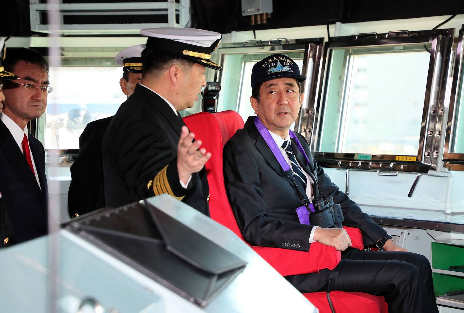 Japan's Abe Shinzo inspects the destroyer Takanami this month before the ship deployed to the Middle East (STR/AFP/Getty Images)