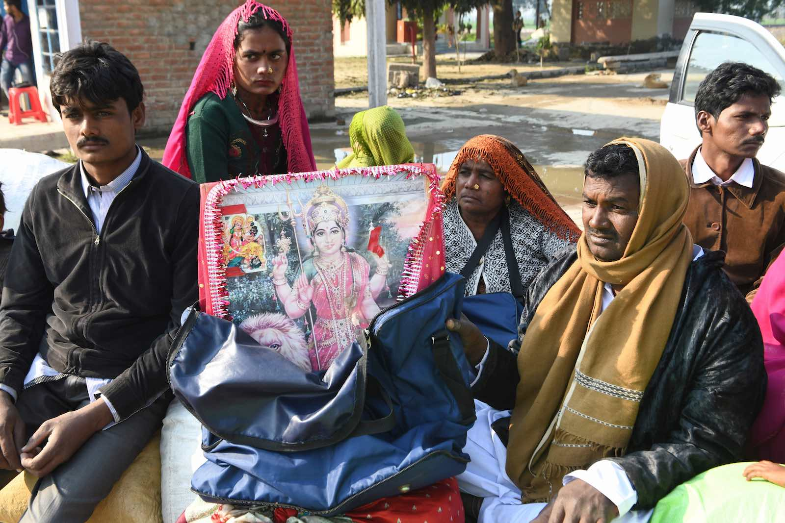 Pakistani Hindu pilgrims wait at the India-Pakistan Wagah border post, near Amritsaron 3 February. (Narinder Nanu/AFP/Getty Images)
