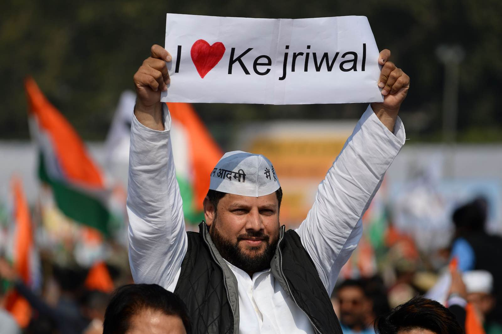 A supporter of the Aam Aadmi Party after Arvind Kejriwal's victory as Delhi Chief Minister (Photo: Sajjad Hussain/AFP/Getty Images)