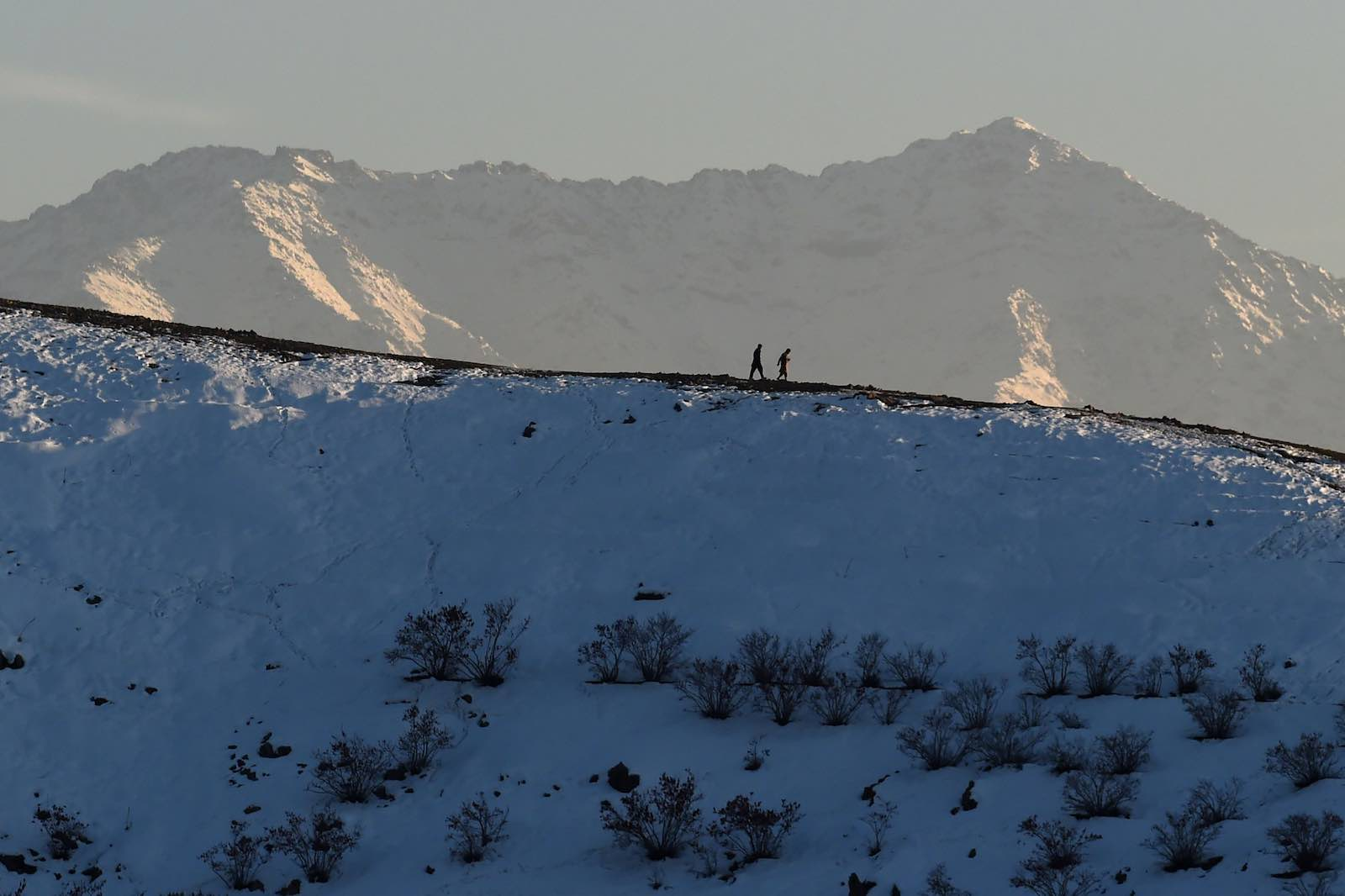 Walking the hillsides near Qargha Lake on the outskirts of Kabul (Wakil Kohsar/AFP/Getty Images)