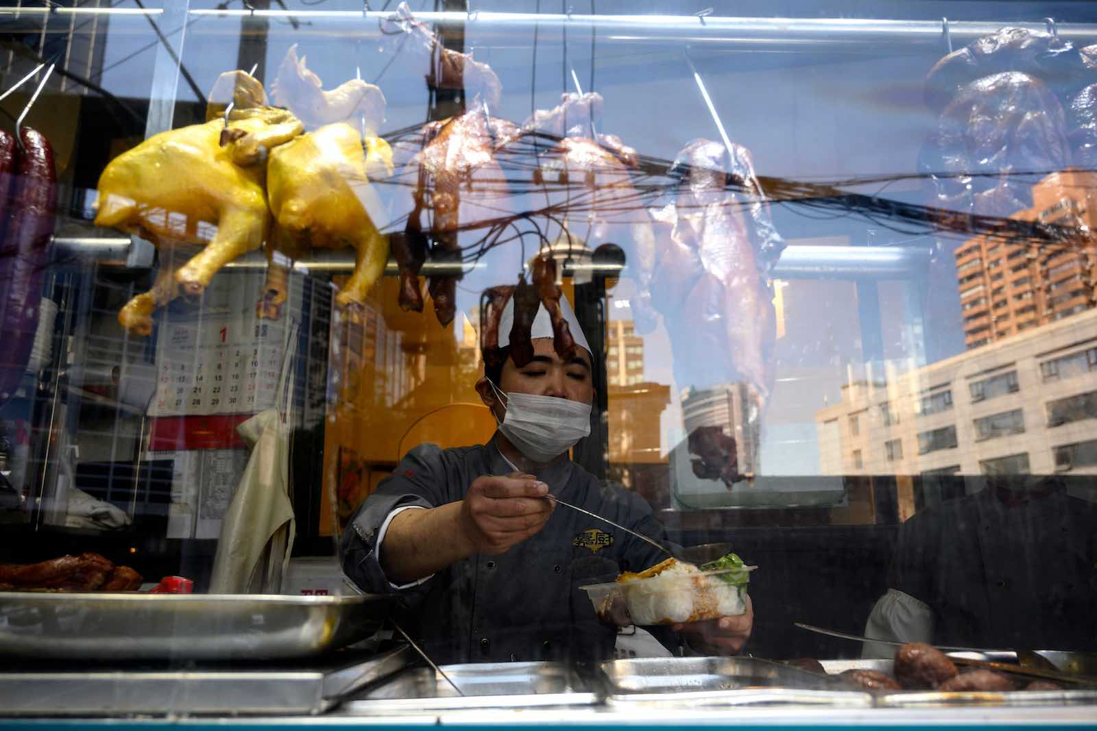 A restaurant window in Shanghai, 18 February (Noel Celis/AFP via Getty Images)